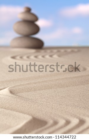 zen garden meditation stone pattern of rocks and sand concept for relaxation and concentration trough simplicity balance and serenity - stock photo