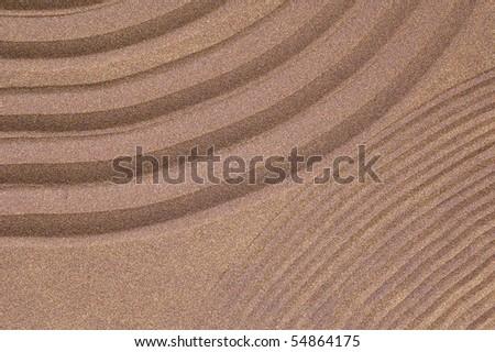 zen garden of sand with copy-space - stock photo