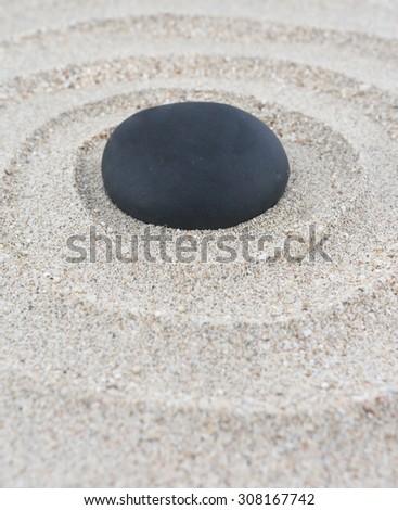 Zen garden - spa stone in the sand. Meditation, spirituality and harmony concept - stock photo