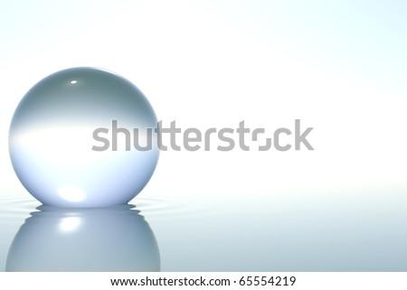 Zen glass sphere in zen water on white background - stock photo