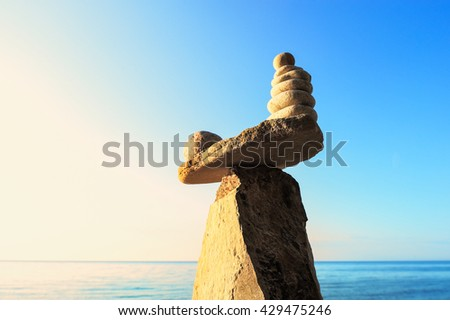 Zen-like of stones on the sky background - stock photo