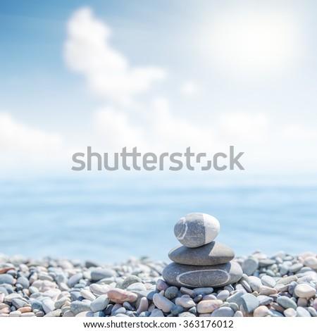 zen like stones on beach. soft focus - stock photo