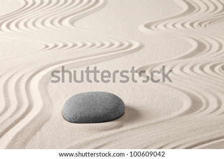 zen meditation rock and sand japanese garden concept for harmony simplicity balance relaxation and spirituality - stock photo
