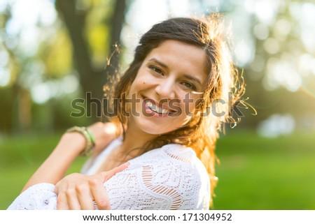 Zen multi-ethnic girl enjoying warmth in a summer sunset - stock photo