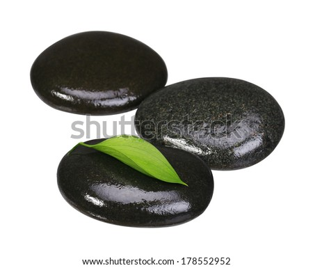 Zen pebbles. Spa Stones and Green Leaf isolated on white. Health Care and Meditation Concept.