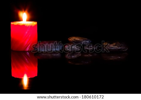 zen stones and aromatic candles on dark background. - stock photo