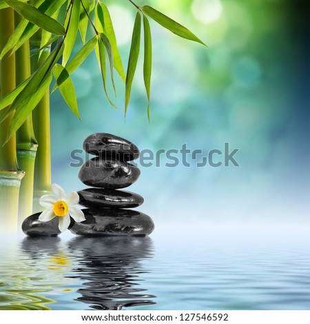 Zen Stones and Bamboo on the water - stock photo