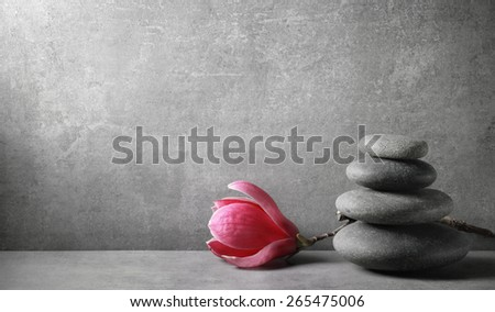 Zen stones and magnolia flower on vintage background - stock photo