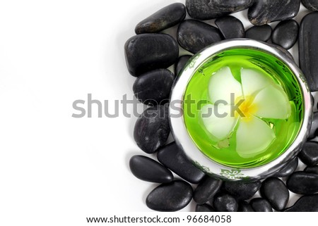 zen stones and White frangipani flower with text space isolated on white