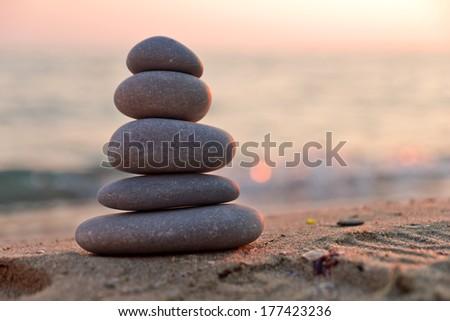 Zen stones at sunset - stock photo