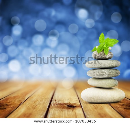 zen stones on the old wood and abstract blue background - stock photo