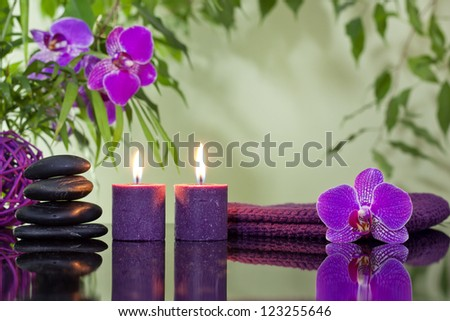 Zen stones orchid aromatic candles and towel spa concept - stock photo