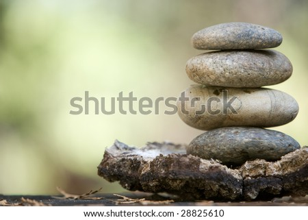 Zen stones stacked on a grass matte at day spa