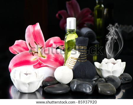 zen. thai oil massage accessories. spa and wellness concept. candles, lily flower and stones - stock photo