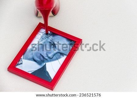 zerbrochner photo frames and high heels. symbolic photo for divorce, separation and relationship crisis - stock photo
