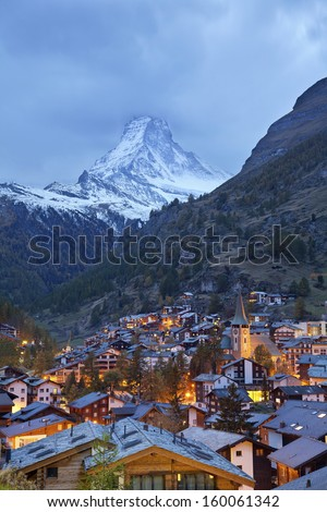 Zermatt and Matterhorn. Image of Zermatt and the Matterhorn taken during twilight blue hour. - stock photo