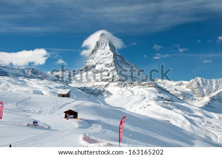 ZERMATT - JANUARY 17: Panorama of the Matterhorn ski paradise on January 17, 2013 in Switzerland. View from Riffelberg station. - stock photo