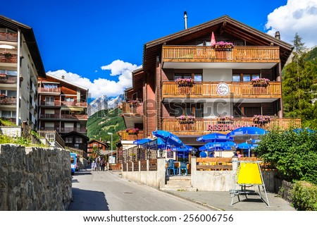 ZERMATT, SWITZERLAND - 17 AUGUST 2011: Urban scenery with famous swiss city Zermatt and wooden chalets in European Alps center of alpine sports. - stock photo