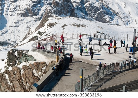Zermatt, Switzerland, March 12 -  2015: Start of a ski piste near the station om the Gornergrat mountain with a lot of skiers - stock photo