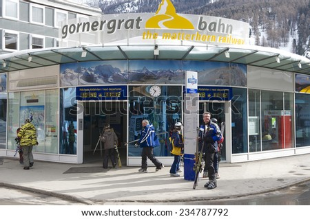 ZERMATT, SWITZERLAND - MARCH 04, 2009: Unidentified tourists enter Gornergratbahn train station in Zermatt. Zermatt is one of the most popular ski resorts in Switzerland. - stock photo