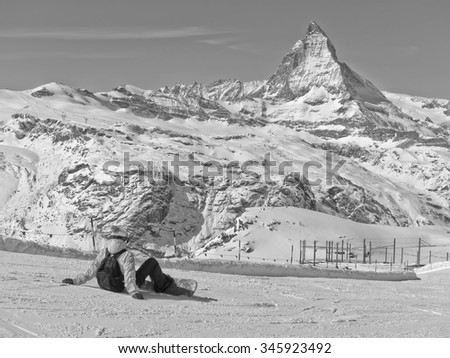 Zermatt, Switzerland - March 22, 2011: View of Matterhorn with a skier sitting on the hill from Gornergrat, Zermatt, Switzerland on March 22, 2011. - stock photo