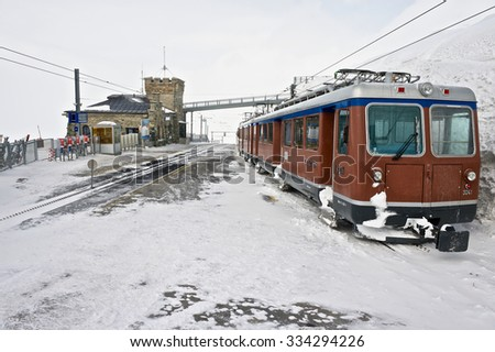 ZERMATT, SWITZERLAND - MARCH 04, 2009: View to the Gornergratbahn railway upper station and the train in Zermatt, Switzerland. - stock photo