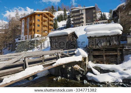 ZERMATT, SWITZERLAND - MARCH 03, 2009: View to the hotels and historical wooden buildings in Zermatt, Switzerland. Zermatt is a famous car-free ski resort in Switzerland.  - stock photo