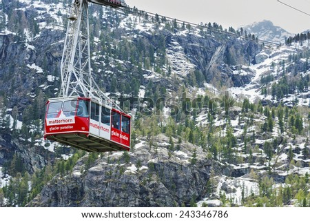 ZERMATT, SWITZERLAND- MAY 19 : Cable car to Matterhorn mountain on May 19, 2014 in Zermatt , Switzerland. It is 2707 metres long and spans an elevation of some 1057 metres. - stock photo