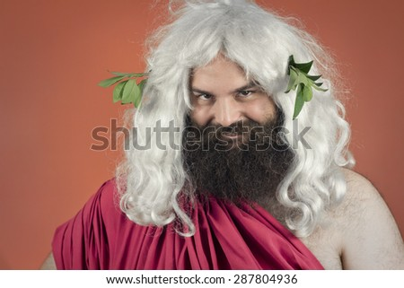 Zeus god or Jupiter bites lip against an orange background - stock photo