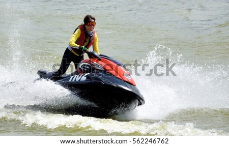 ZHAOQING, CHINA - JUNE 26: A female athlete is playing motorboat on water, on June 26, 2016 in ZhaoQing city. ZhaoQing is a developing city locates in South of China.