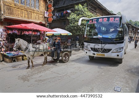 Zhaoxing Dong Village, Guizhou Province, China -  April 8, 2010: Chinese Public transport in the countryside of ethnic minorities,  shuttlebus and horse drawn vehicle.
