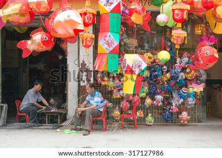 ZHONGSHAN GUANGDONG CHINA - SEP 16, 2015: store sells different lanterns for Chinese Mid Autumn Festival on SEP 16, 2015 in Zhongshan, Guangdong, China. SEP 27 is the Mid Autumn Festival for 2015.