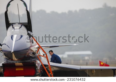 ZHUHAI, CHINA - NOV. 10. 2014:Pilots preparing Chinese J-10 airplane for flight on Airshow China 2014 in Zhuhai, Guangdong province.