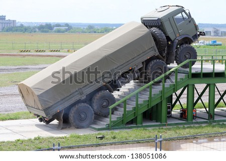 ZHUKOVSKY - JUNE 25: Military KAMAZ truck overcomes stairs at demonstrations of technique at second International Forum Engineering Technologies 2012, on June 25, 2012 in Zhukovsky near Moscow, Russia - stock photo