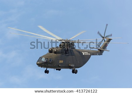 """ZHUKOVSKY, MOSCOW REGION, RUSSIA - AUG 27, 2015: A demonstration flight Russian heavy transport helicopter Mi-26 """"Halo"""" at the International Aviation and Space salon MAKS-2015 - stock photo"""