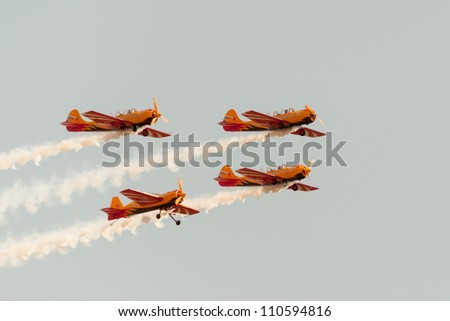 ZHUKOVSKY, MOSCOW REGION/RUSSIA - AUGUST 10: Aerobatic sport team First Flight on 3 Yak-52 and Yak-54 trainer. Airshow devoted 100th anniversary of Russian Air Forces on August 10, 2012 in Zhukovsky. - stock photo