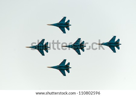 ZHUKOVSKY, MOSCOW REGION/RUSSIA - AUGUST 10: 5 Su-27 Flanker of The Russian Knights aerobatic team. Airshow devoted to 100th anniversary of Russian Air Forces on August 10, 2012 in Zhukovsky. - stock photo