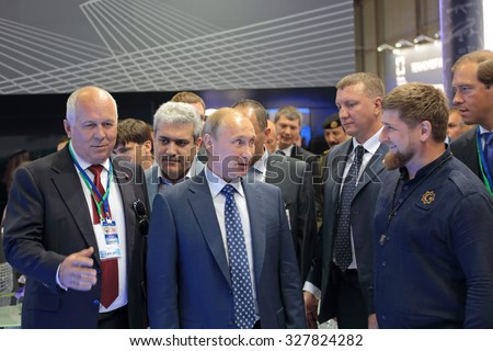 ZHUKOVSKY, RUSSIA - AUG 25, 2015: The CEO of Rostec Corporation Sergey Chemezov, President Vladimir Putin and head of Chechnya Ramzan Kadyrov at the International Aviation and Space salon MAKS-2015 - stock photo