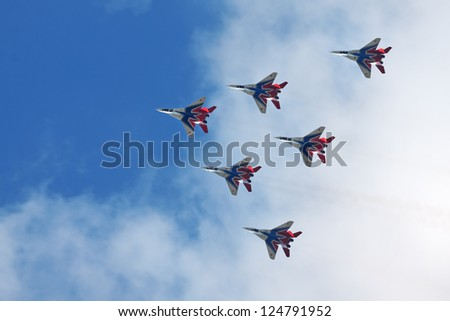 ZHUKOVSKY, RUSSIA - AUGUST 19: Aerobatic team Swifts (Strizhi) at the International Aviation and Space salon (MAKS) on August 19, 2011 in Zhukovsky, Russia - stock photo
