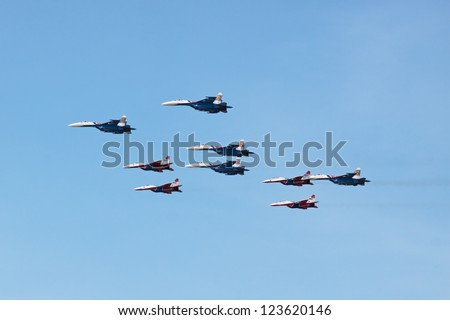 ZHUKOVSKY, RUSSIA - AUGUST 13: Aerobatic teams Swifts (Strizhi) and Russian Knights at the International Aviation and Space salon (MAKS) on August 13, 2011 in Zhukovsky, Russia