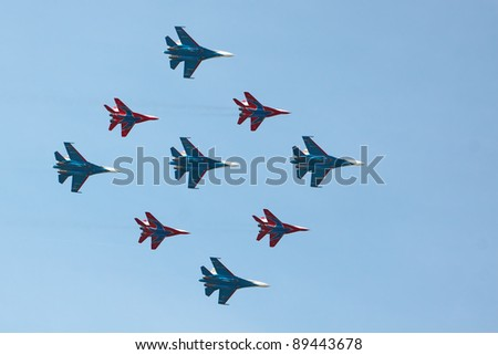 ZHUKOVSKY, RUSSIA - AUGUST 13: aerobatic teams Swifts (Strizhi) and Russian Knights at the International Aviation and Space salon (MAKS) on August 13, 2011 in Zhukovsky, Russia - stock photo