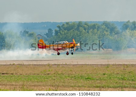 ZHUKOVSKY, RUSSIA - AUGUST 12: Yak-52 plane from Pervyj Polyot display team lands during the celebration of the centenary of Russian Air Force on August 12, 2012 in Zhukovsky, Russia