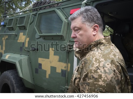 ZHYTOMYR REG, UKRAINE - May 27, 2016: President, Supreme Commander-in-Chief of the Armed Forces of Ukraine Petro Poroshenko at the military training area of the AFU highly mobile airborne troops - stock photo