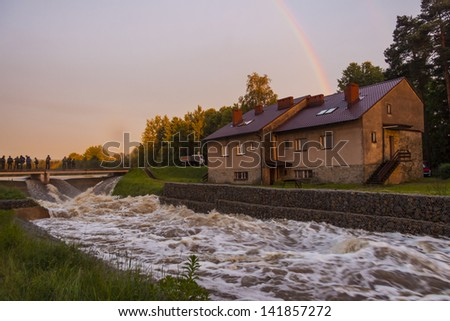 ZIELONA, POLAND - JUNE 11:Man from fire brigade make sandbank from sand bags on june 11, 2013 in Kalety. High water level on Zielona lake and Mala Panew river. - stock photo