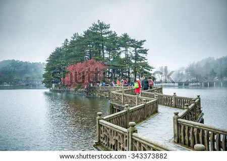 zigzag bridge on the lake with mist and cloud in lushan mountain - stock photo