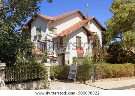ZIKHRON YAAKOV,ISRAEL-AUG 20,2016:Houses on main street, Zichron Yaakov, Israel.It was one of first Jewish settlements in Israel(1882) by Baron Rothschild.Town draws tourists to historic city center