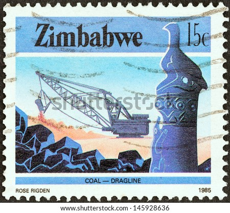 """ZIMBABWE - CIRCA 1985: A stamp printed in Zimbabwe from the """"National Infrastructure"""" issue shows Dragline coal mining, circa 1985.  - stock photo"""