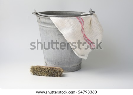 Zinc bucket with cloth and brush - stock photo