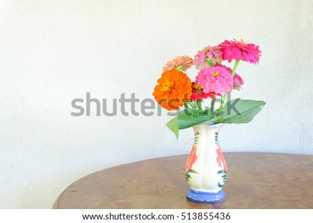 zinnia flower in a vase