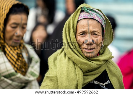 ZIRO, ARUNACHAL PRADESH/INDIA - DECEMBER 14, 2013: Women of the Apatani tribe, with nose plugs, The Apatani are a tribal group of people living in the Ziro valley in Arunachal Pradesh, India.